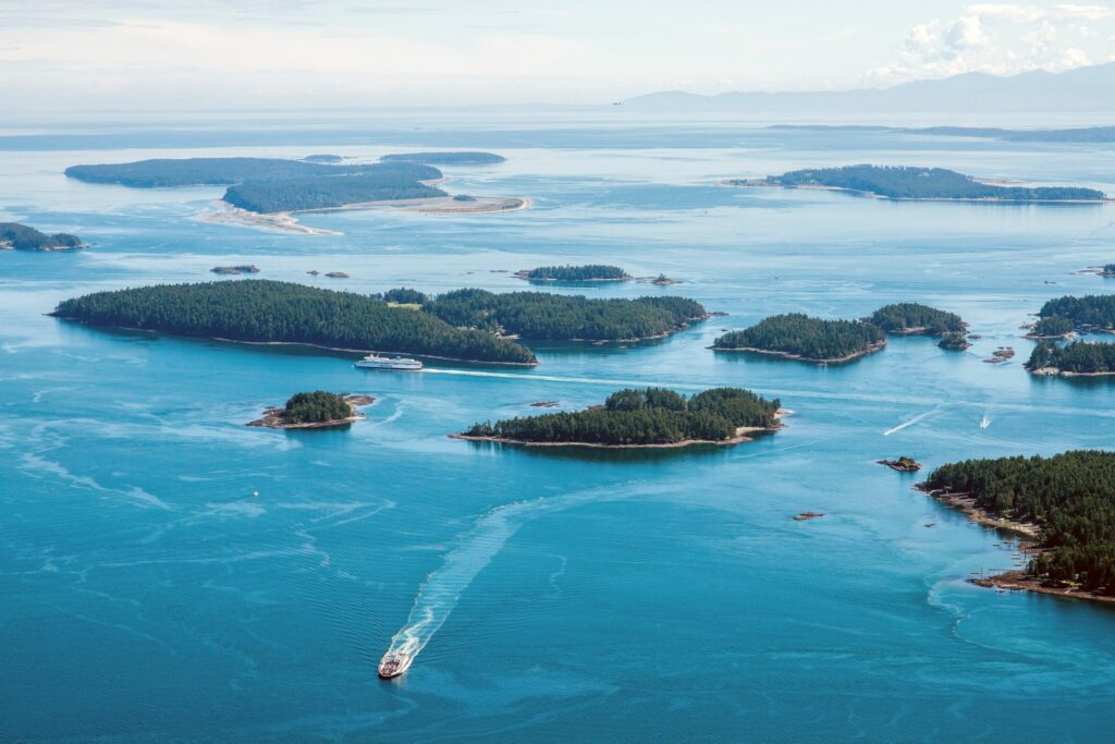 A boat travels through the Gulf Islands near Salt Spring island, Canada. (Photographer: James MacDonald/Bloomberg)