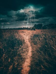 A path in a field leading to a lightning strike.
